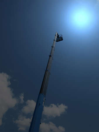 high long industrial crane arm with cradle on dark blue sky with clouds. abstract magic light concept Stock Photo - 10060922