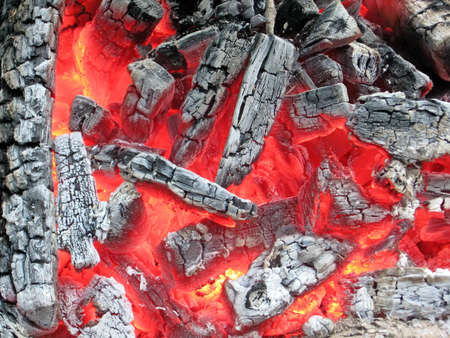 red campfire with hot coal and ashes, burn fire closeup details photo