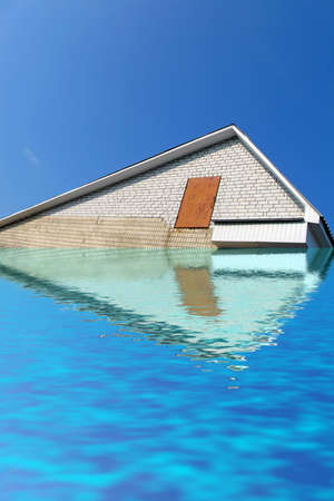 abstract triangle roof from white brick under water, house on blue sky. stress envronment concept photo