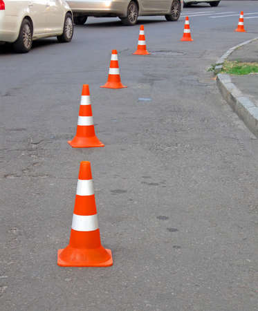 abstract orange road cones heap, security barrier details photo