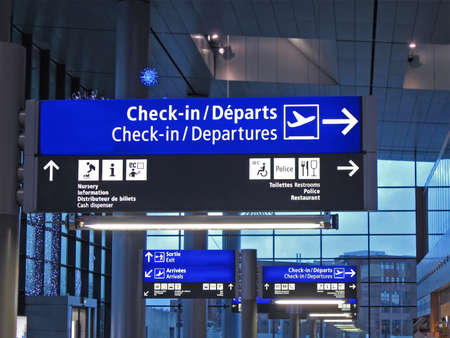 The new airport gate board (blue color) sign showing the aeroplane boarding direction, gate numbers (gateway) for boarding and check-in (check in) time. big colorful display, public information. Modern plane is most universal idea for global earth voyage. Stock Photo - 10719783
