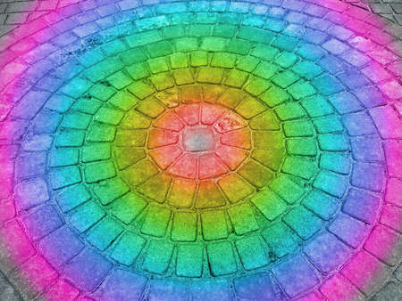 focus on center. abstract rainbow light on round stone building, industrial geometry details
