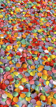 abstract color diversity christmas confetti. vertical background paper texture closeup photo