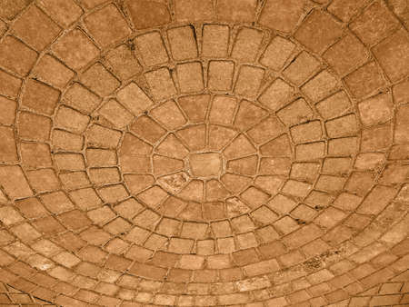 focus on center. abstract golden round stone building, wall geometry details photo