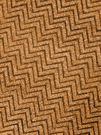 abstract golden zigzag wool carpet background texture, wool closeup details