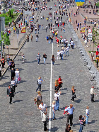 people crowd walking over the stone brick street in Kiev on May 09, 2010. clothing diversity