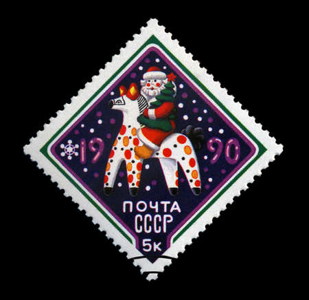 USSR - CIRCA 1989: cancelled stamp printed in the USSR, shows russian Santa Claus with pine-tree on folktale horse for New Year, circa 1989. Happy New Year 1990 as text. Stock Photo - 11595074