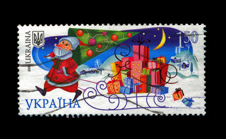 UKRAINE - CIRCA 2008: cancelled stamp printed in UKRAINE, shows russian Santa Claus with pine-tree as folktale person for New Year, circa 2008. Happy New Year 2009 as text. photo