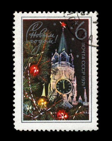 USSR - CIRCA 1970: cancelled stamp printed in the USSR, shows Kremlin tower with red star, decorated fir-tree for New Year, circa 1970. Happy New Year 1971 as text. Stock Photo - 11595100
