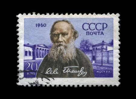 USSR - CIRCA 1960: cancelled stamp printed in USSR, shows famous russian writer Lev Tolstoy, circa 1960. vintage post stamp on black background. photo
