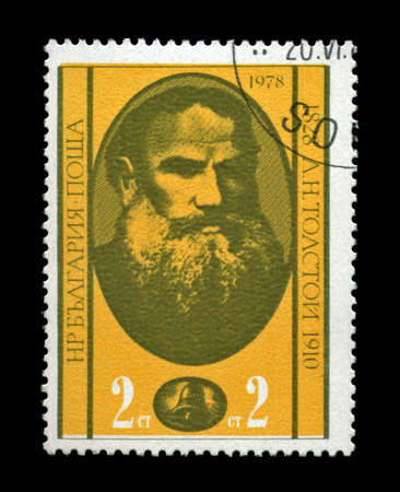 BULGARIA - CIRCA 1978: cancelled stamp printed in Bulgaria, shows famous russian writer Lev Tolstoy, circa 1978. vintage post stamp on black background. photo