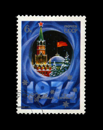 USSR - CIRCA 1973: cancelled stamp printed in the USSR, shows Kremlin tower with red star, red USSR flag, fir-tree, snow for New Year, circa 1973. Happy New Year 1974 as text. Stock Photo - 11790742
