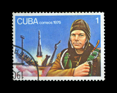 gagarin: CUBA - CIRCA 1976: cancelled stamp printed in CUBA, shows first russian, soviet astronaut Yury Gagarin, space-vehicle launching site, shuttle start, circa 1976. vintage post stamp on black background.