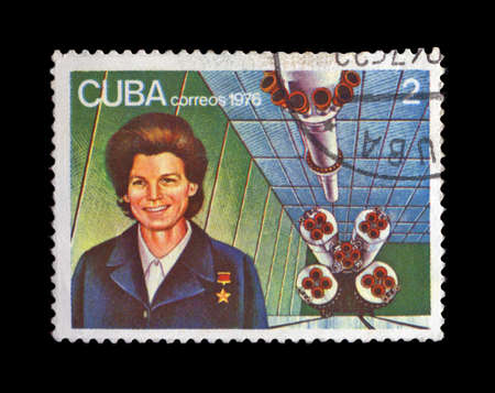CUBA - CIRCA 1976: cancelled stamp printed in CUBA, shows first russian, soviet astronaut Valentina Tereshkova, rocket shuttle, circa 1976. vintage post stamp on black background.