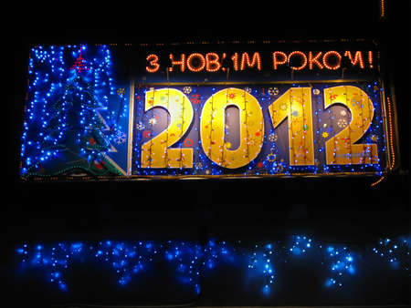 happy new year 2012 as big advertising board (text on ukrainian). power illumination details