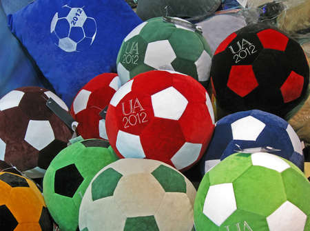 KIEV - FEBRUARY 01: Sport balls with football emblem at the Decor exhibition (February 01-04) on February 01, 2012 in Kiev, UKRAINE. Suvenir pillows devoted to EURO 2012 Football Championship in Ukraine and Poland in summer 2012.