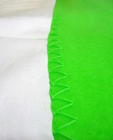 edging: focus on center. abstract green seam edging, modern textile details