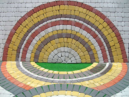 colorful round figure on brick wall, color symmetry details Stock Photo - 12370673