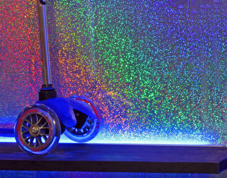 new car lots: blue wheel on rainbow background. abstract blue spots diversity, new disco details