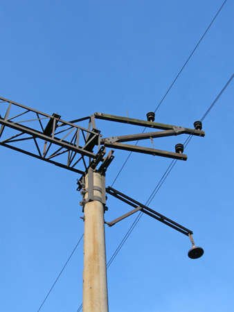 isolators: electrical power line with many wires and powerful isolators on blue sky. vintage electricity pylon