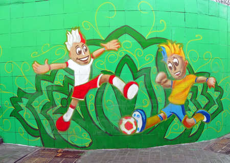 KIEV - FEBRUARY 26: Sport soccer funs in national clothing on February 26, 2012 in Kiev, UKRAINE. Color graffiti on the green stone wall devoted to EURO 2012 Football Championship in Ukraine and Poland in summer 2012. Stock Photo - 12679753