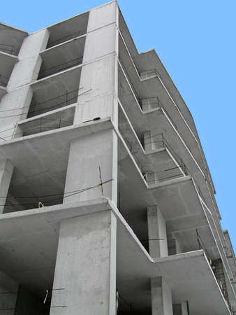 modern construction site on blue sky, concrete skyscrapper building details