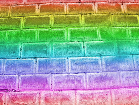 abstract damaged rainbow brick wall background, retro construction texture photo