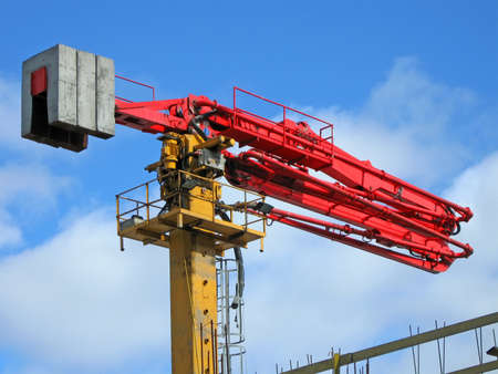 one industrial red color crane on blue sky with  white clouds, construction site  new building concept photo