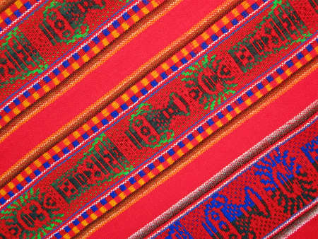 colorful weave silk shawl  different zigzag colors background  closeup texture, new fabric diversity concept  photo