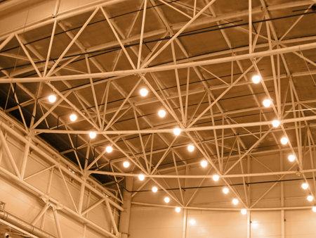 interior yellow color warehouse construction lighting  kyoto, industrial bulb lamp illumination concept Editorial