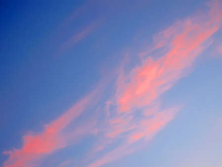 blue sky with pile of red color clouds, sunset details photo