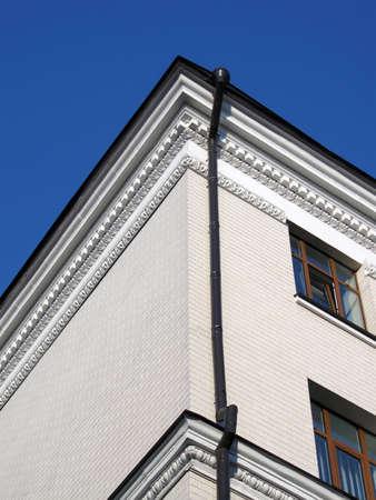 white brick building on blue sky, architecture details photo