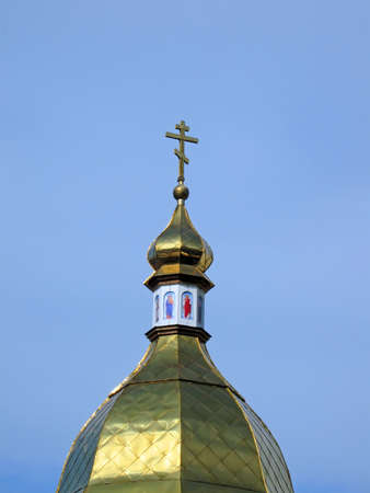 golden religious sign on blue sky with clouds. new cathedral bible construction concept Stock Photo - 13567678