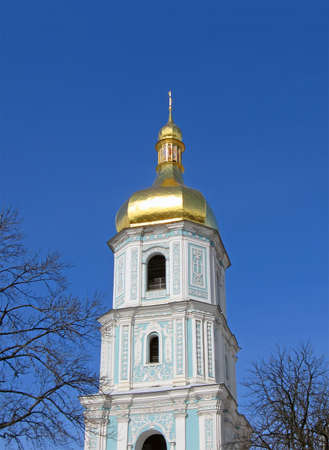 Golden religious sign on blue sky with clouds in kiev, ukraine. new cathedral bible construction  concept photo
