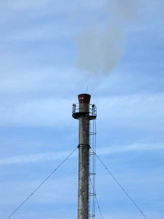 one pipe pylone with steam smog on blue sky with clouds. save environment concept Stock Photo - 13567700