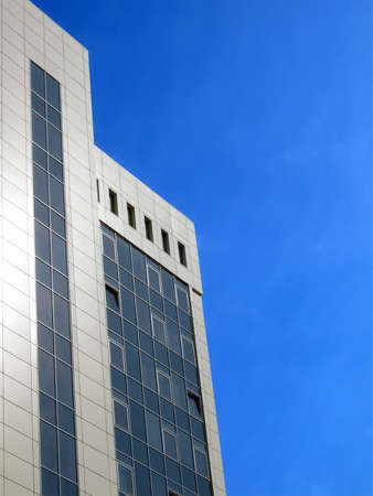 one high glass reflective office building with many windows on blue sky in sunny day, modern urban real estate construction Stock Photo - 13591255