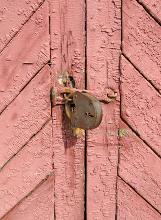 retro brown, red vintage paint wall, old wood rusty locked door construction concept photo