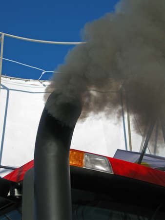 black smog from industrial car pipe, environment pollution details photo
