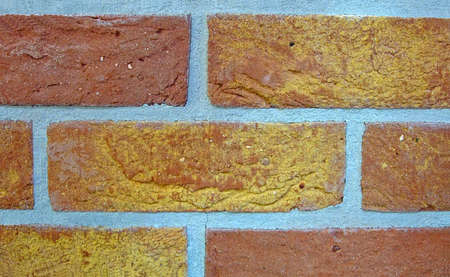 red brick wall with cement, stone wall texture closeup photo