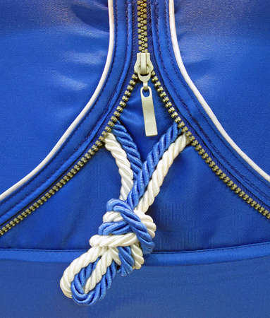 one blue knot, yarn textile texture. new zip security concept Stock Photo - 13657076