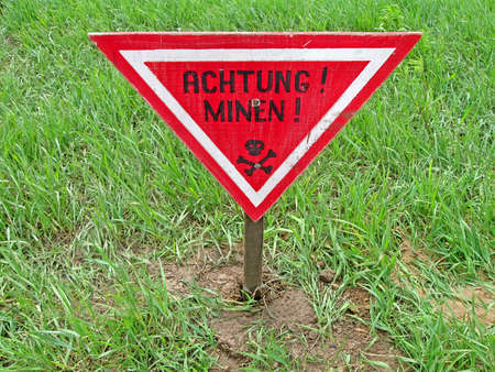 ahtung minen as text on german language, danger red sign warning photo