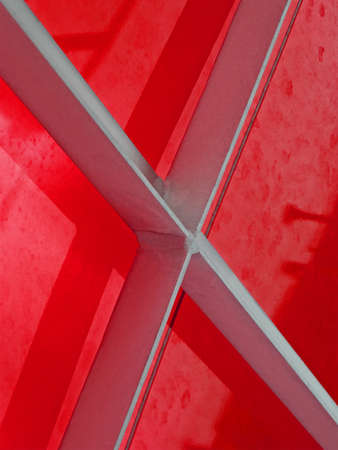 abstract metal construction covered with red material, industry details photo