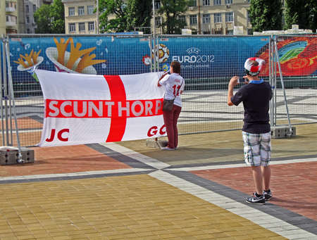 KIEV, UKRAINE - JUNE 15: Sport fun making photo of England flag before match England-Sweden on June 15, 2012 in Kiev, UKRAINE. EURO 2012 football championship started on June 08 in Ukraine and Poland.  Stock Photo - 14145919