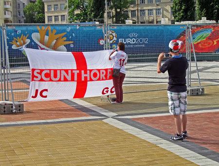 KIEV, UKRAINE - JUNE 15: Sport fun making photo of England flag before match England-Sweden on June 15, 2012 in Kiev, UKRAINE. EURO 2012 football championship started on June 08 in Ukraine and Poland.  Stock Photo - 14145919