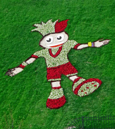 KIEV, UKRAINE - JUNE 11: EURO 2012 talisman from flowers and green grass on June 11, 2012 in Kiev, UKRAINE. EURO 2012 football championship started on June 08 in Ukraine and Poland.