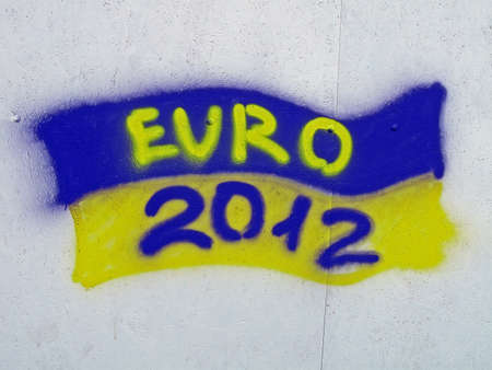 KIEV, UKRAINE - JUNE 19: Ukrainian flag with EURO 2012 text as graffiti on June 19, 2012 in Kiev, UKRAINE. EURO 2012 football championship started on June 08 in Ukraine, Poland.  Stock Photo - 14145925