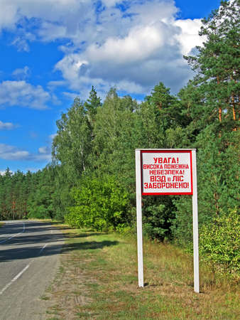 warning message near the forest  attention  High fire hazard  Forest entrance prohibited  as text on ukrainian language, environment details photo