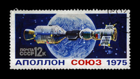 soyuz: USSR - CIRCA 1975  stamp printed in USSR  Russia  shows experimental flight of Soyuz and Apollo spaceship, circa 1975  vintage post stamp isolated on black background  Editorial