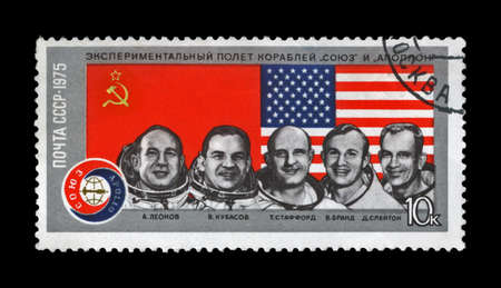 USSR - CIRCA 1975  canceled stamp printed in USSR shows astronauts from the Apollo-Soyuz Test Project as 1st joint flight of the USA and USSR, circa 1975  vintage post stamp isolated on black background  Stock Photo - 14596936