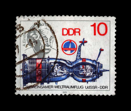 DDR  GERMANY  - CIRCA 1979  A post stamp printed in Germany shows spaceship and portrait of scientist Albert Einstein, circa 1979  vintage post stamp isolated on black background